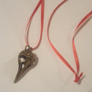 bronze_bird_skull_on_red_ribbon